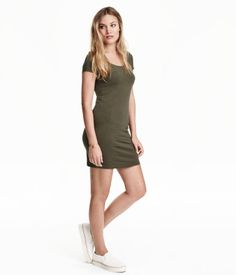 Short fitted dress in cotton-blend jersey with a slightly lower neckline and short sleeves.