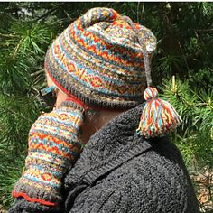 A ladies' Fair Isle style hat and fingerless mittens set, with the mittens sized for warmth + access, covering all but the fingertips.