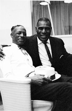Son House and Howlin Wolf.......pioneer bluesmen