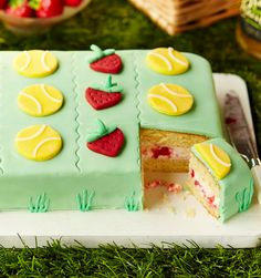 Get into the spirit of Wimbledon with a classic strawberry and cream filling dressed in colourful layers of fondant icing. So simple and a fun baking project for little ones to get involved in.