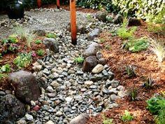 Dry Creek Rock Bed Creates a Stunning Outdoor Walkway