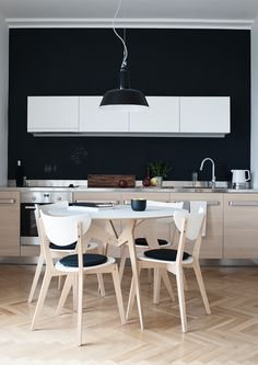 black wall and modern white / wood kitchen