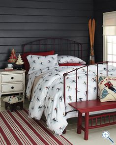 What a cute room! Subtle theme, rustic vintage ski. Want this understated theme with the boys fireman room