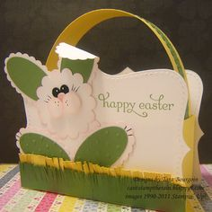 """A green and yellow basket :)Cardstock: Whisper White, So Saffron, Wild Wasabi Stamps: Delightful Dozen Inks: Wild Wasabi, Pretty in Pink, Basic Black, White (gel pen) Tools: Big Shot, Perfect Polka Dots embossing folder, Top Note die, Scallop circle punch, Scallop oval punch, Large Oval punch, 1/2"""" circle punch, (hole punch), Dotted Scallop Border punch"""