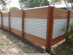Corrugated metal and wood plank fence / screen. Perfect to hide air conditioners and trash containers.
