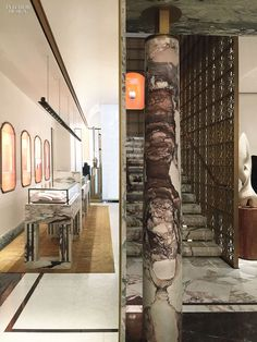 In a VIP room at London's Bulgari store by Peter Marino Architect, a custom sofa in silk velvet sits near a marble-topped table with a base in sterling silver. P...