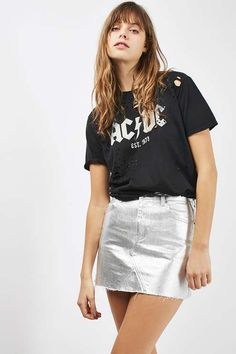 Add cool character to your outfit with this highwaisted denim coated skirt in a striking silver metallic. In a classic mini cut, it sits above the knees. We've styled with a band t-shirt and ankle boots for an edgy update. #Topshop