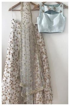 This stunning lehenga set is a cocktail favourite. Rock it at your friend's reception or a chill diwali party. Floral black and peach lehenga set. Indian Fashion Dresses, Indian Gowns Dresses, Dress Indian Style, Indian Designer Outfits, Eid Dresses, Half Saree Designs, Lehenga Designs, Indian Wedding Outfits, Indian Outfits