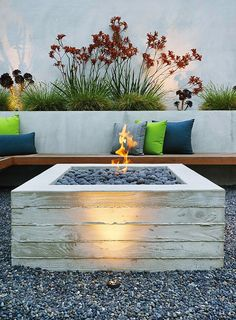 A cantilevered ipe bench hugs a custom board-formed concrete fire pit. Photo 3 of 7 in Outdoor Fireplaces and Fire Pits We Love by Zachary Edelson from A Craftsman-Style Bungalow is Turned Inside Out Fire Pit Table, Diy Fire Pit, Fire Pit Backyard, Outdoor Gas Fire Pit, Backyard Camping, Backyard Seating, Gas Fire Pits, Diy Propane Fire Pit, Cozy Backyard