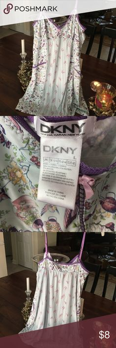 Dkny chemise size Tagged L but fits medium Silky slip chemise. Adjustable straps. Can fit medium easily. A large is on the label , but would fit both medium and large   Colors are mint and purple and rose.  Gently worn Dkny Intimates & Sleepwear Chemises & Slips