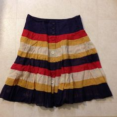 Edme & Esyllte skirt Striped full skirt with button details from anthroplogie. Really cute skirt, slight poof to it. Tag size 10, but can fit a variety of sizes because it's a fuller style. Second photo shows true colors. I accept reasonable offers! Cat friendly, smoke-free home. Anthropologie Skirts A-Line or Full