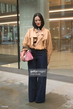 Selfridges fashion buyer Tiffany Hsu wears Loewe jacket and bag, Charlie May jeans and JW Anderson collar on day 4 during London Fashion Week Spring/Summer 2016/17 on September 21, 2015 in London, England.