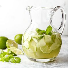 This delicious white wine sangria is guaranteed to be a hit. Honeydew melon, cucumber, lime and fresh mint leaves give a fresh, fruity taste to this homemade white sangria recipe. Summer lovin' is as close as your cup! Refreshing Summer Drinks, Fun Drinks, Yummy Drinks, Alcoholic Drinks, Beverages, Gold Drinks, Fruity Sangria Recipe, Sangria Recipes, Cocktail Recipes