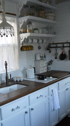 The Kitchen inside the Shabby Chic Tiny Retreat | Tiny House Living