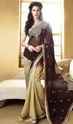 Fashion the flawless triumph of art dressed in this brown and yellow color georgette half n half sari. You can see some fascinating patterns done with lace and resham work. #attractiveembroideredsaree #eveningwearsari #indianwomensaris
