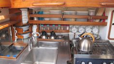 Note corner storage of plates and bowls and storage of thermos flasks. Galley- Robert Clark 43 ft Masthead Sloop 1962