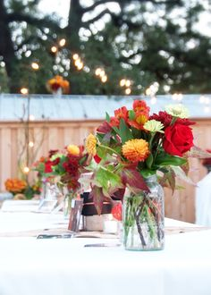 Centerpieces for outside wedding  reception table by Cindy Davis Design Group
