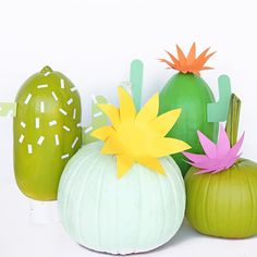 Disguise your fall pumpkins as a colorful group of cacti.