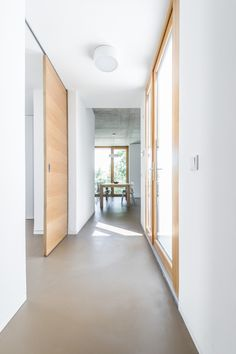 A typical square house with a hipped roof stood on the suburban plot when we were invited to take on the project. Painted Concrete Floors, Plywood Floors, Stained Concrete, Concrete Countertops, Laminate Flooring, Concrete Lamp, Floor Design, House Design, Interior Decorating