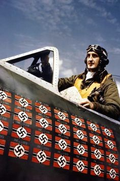 World War II in colour - England, circa 1945 Ace American pilot Lieutenant Colonel Francis S. Gabreski poses in a cockpit. The flags refer to the 28 enemy planes brought down by Gabreski. If you look closely above the swastikas it names the type of plane shot down.