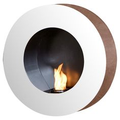 Wall-mounted gel fuel fireplace with a circular design and polished stainless steel finish.  Product: FireplaceConst...