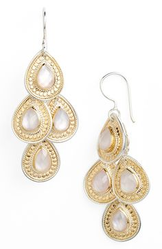 Lovely gold and rose quartz chandelier earrings that boast a chic, carefree vibe.