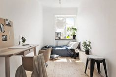 A perfectly decorated narrow bedroom in a Stockholm pad