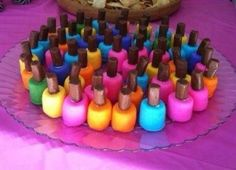 Such a cute idea! Marshmallows dipped in colorful frosting & topped with a tootsie roll make adorable and yummy nail polish treats! Great for a little girls party.