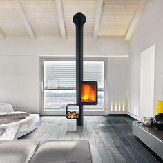 Sleek black wood stove by Focus Creations