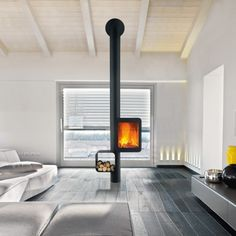 Sleek black wood stove by Focus Creations