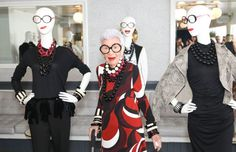 Iris Apfel poses with mannequins wearing looks from the Iris Meets INC collection. Photo: BFA