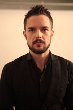 Brandon Flowers - change to blue eyes and this is *almost* Kevin.  ;)