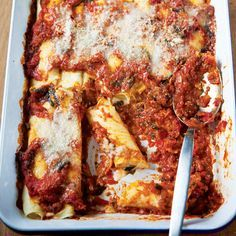 Manicotti ~ For some Italian-American families, Thanksgiving is traditionally preceded by a pasta course: manicotti, filled at a family gathering the night before.