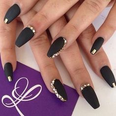 Matte black nails with gold designs