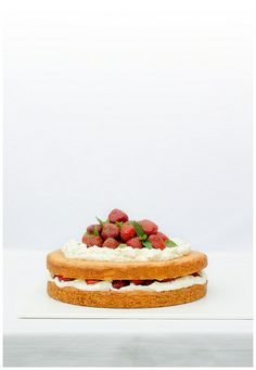sponge cake with whipped cream, mascarpone and strawberries