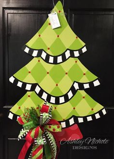 "Harlequin is such a classic Christmas design. What's more beautiful than this harlequin Christmas tree? Such a statement piece for your front door! Hand painted in the USA. Made of 1/4"" thick wood and painted on the back for a polished look.32"" tall x 24"" wide"