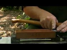 Ray Mears - How to sharpen an axe at camp, Bushcraft Survival