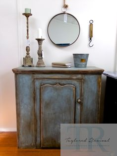 Renee is a gorgeous character piece, beautifully rustic with shades of blues, greys, yellows and hints of rusty red. Made of solid Kauri with a cupboard door and internal shelving. She has been given a unique revival, hand painted in layers of pure white louis blue, blended louis blue, arles and primer red then sanded and scraped back to give her, a beautiful rustic charm.#annie #sloan #chalk #paint #taylored #revival #pure #white #louis# blue #arles #primer #red