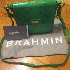 "Sale NWT beautiful green Brahmin cross body final price reduction price firm  get it now New Brahmin Green embossed leather crocodile. With registration and dust cover 10"""" tall by 9"" wide  2 3/4  side width snap closure outside pocket  under flap outside pocket phone pocket and inside zipper pocket..sorry no bundles on purses Brahmin Bags Crossbody Bags"