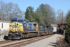 CSXT 7892 is a General Electric (GE) C40-8W type locomotive built in 1993. For twenty four years, it has worn the same paint scheme and worked for the same railroad. It is pulling an ethanol train westward (railroad south) through the small hamlet of Catawba, South Carolina. Csx Transportation, Railroad Photography, General Electric, Train Tracks, Paint Schemes, Locomotive, South Carolina, Trains, Type