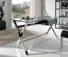 glass topped desk with chrome legs in an office