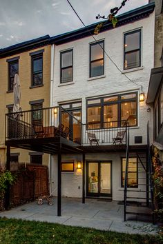 Rear facade with new deck and enlarged windows and doors. Brownstone renovation in Park Slope, Brooklyn. Ben Herzog, Architect.
