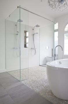 Shower floor - Modern bathroom features a crystal chandelier free standing acrylic tub a mix of marble tile and pebble floor and a double shower with custom made glass panels. Bad Inspiration, Bathroom Inspiration, Bathroom Ideas, Shower Ideas, Shower Bathroom, Bathroom Remodeling, Bathroom Vanities, Master Shower, Spa Shower