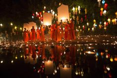 Nov. 17, 2013. Buddhist monks prepare to release sky lantern after a blessing ceremony during the Loy Krathong Festival at a temple in Chiang Mai, Thailand.