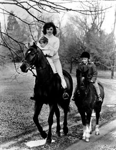 First Lady Jacqueline Kennedy and her children John F. Kennedy Jr. and Caroline Kennedy riding,