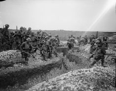 Troops of the 4th Battalion, Gordon Highlanders crossing a trench. Ribecourt, 20 November, 1917.