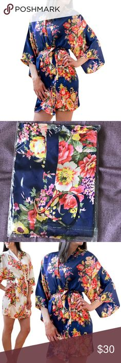 """NWT Navy Floral Satin Bridesmaid Robe Handmade Handmade custom to order by Brideside online. Got these for my bridesmaids but accidentally ordered too many so have extras. Dimensions 35""""L x 46""""W.  Interior tie & exterior belt. Robe has loop holes to hold belt.  Navy ones in sealed packaging (see photo).  Also have separate listing for same Robe in Ivory Floral.  OS = One Size Fits Most. 100% Satin. Brideside Intimates & Sleepwear Robes"""