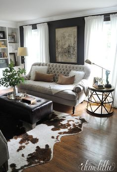 We added some fun throw pillows and beautiful gold tray from @homegoods to help finish off this side of our den. We love the contrast of the white and caramel colored pillows against the dark chocolate walls. (sponsored pin)