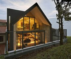 Y-House is a contemporary three story single family semi-detached residence designed by architecture firm ONG&ONG Pte Ltd in Singapore.