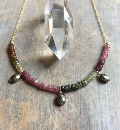 ☆ Please note: This piece is made to order. Stone color sequence may vary. This luxe gemstone necklace features a lovely row of Rainbow Tourmaline gemstone rondelles and a trio of sparkling Pyrite ovals. The gems are strung on to flex wire and then connected to 14k gold filled